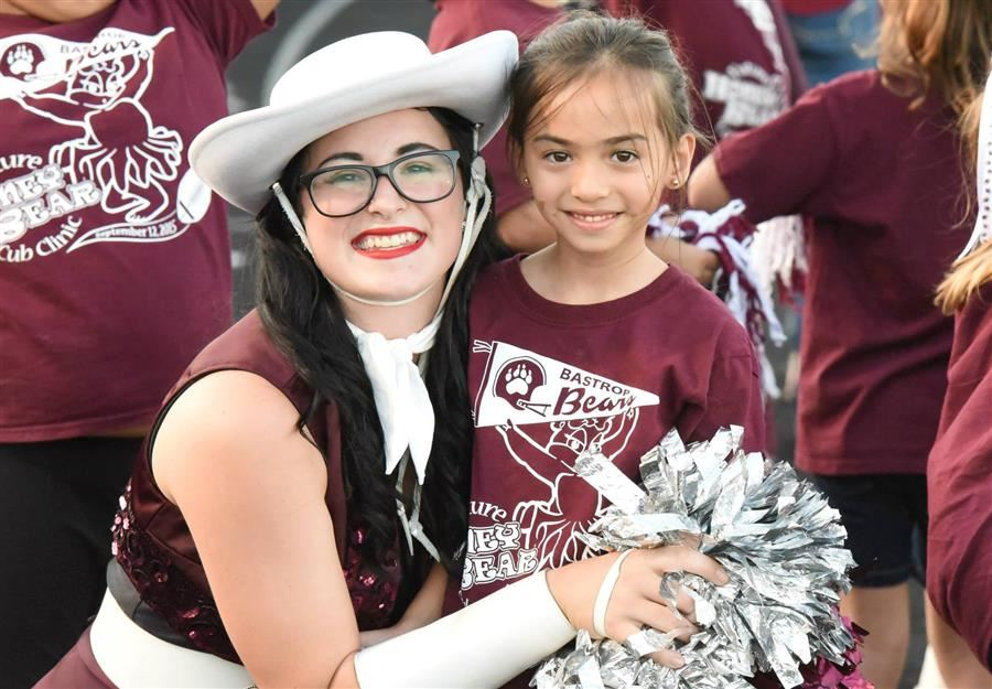 Smiling Cheerleader and elementary student